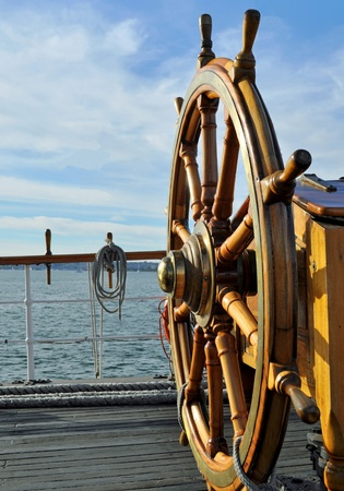 The Wooden Steering Wheel of a Tall Sailing Ship photo