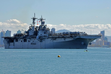 warship: San Diego, California, February 22, 2011: The USS  Boxer departing to provide humanitarian aid, support operations overseas, and combat piracy.
