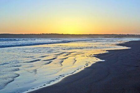 deserted: Sundown on a deserted Beach
