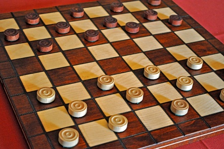 game room: A Classic Checkers set made of Wood.