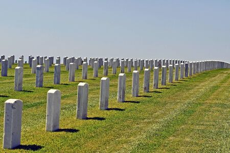 Rows of gravestones at a large cemetary