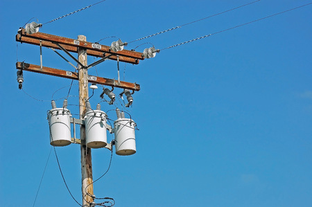 protons: A High Voltage Utility Pole providing Electrical Power to the Community. Stock Photo