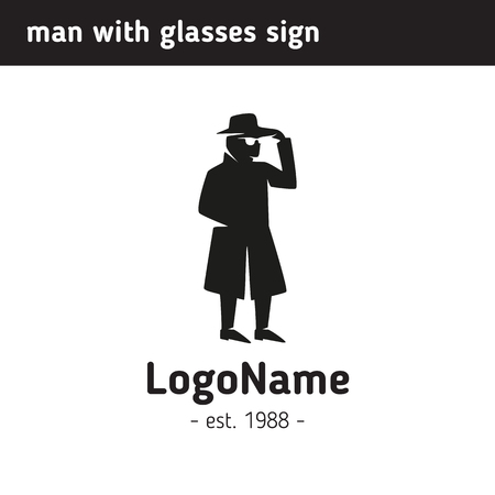 eavesdropper: Sign man in a hat and glasses in a coat