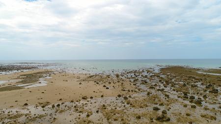 Pakarang beach, Phang Nga, Thailand. December 2017. calm beach at Khao lak. many rock on the beach.