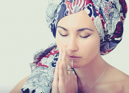 blindly: Portrait of praying girl in a turban