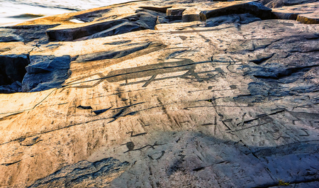 millennia: Attraction of Karelia is Onega petroglyphs - prehistoric rock engravings (4th-2nd millennia BC) carved on the granite shore of the lake on the cape Besov Nos.