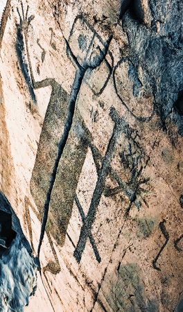 engravings: Fragment of Onega petroglyphs figure of demon - prehistoric rock engravings (4th-2nd millennia BC) carved on the granite shore of the lake on the cape Besov Nos.