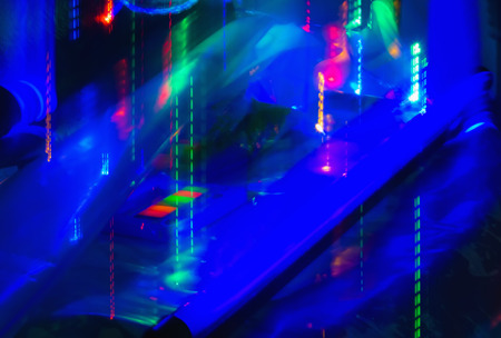 ultraviolet: Abstract background of motion blurred neon lights under ultraviolet  lamp. Stock Photo