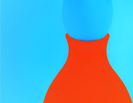 Abstract bicolor design - part of a orange ceramic vase with an egg on a blue background closeup.