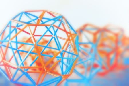 Coloured three-dimensional model of geometric solids closeup defocused - abstract blurred background. Banque d'images