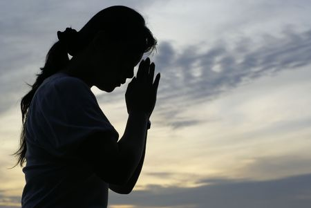 Mujer orando silueta Foto de archivo - 4322150