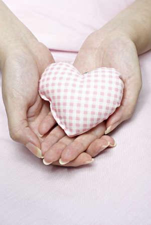 Love shaped cushion in hand Stock Photo - 4788919