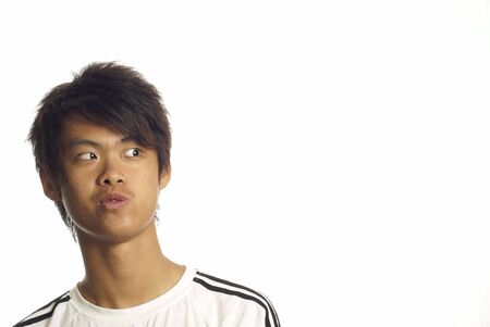 sidewards: Young asian man looking to side Stock Photo