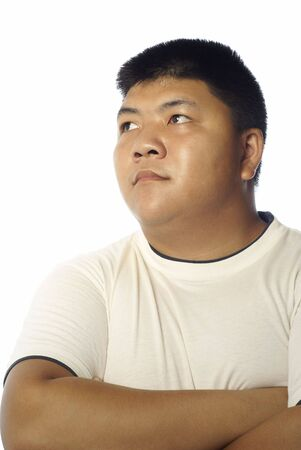 crewcut: Asian man looking to the side with white background Stock Photo