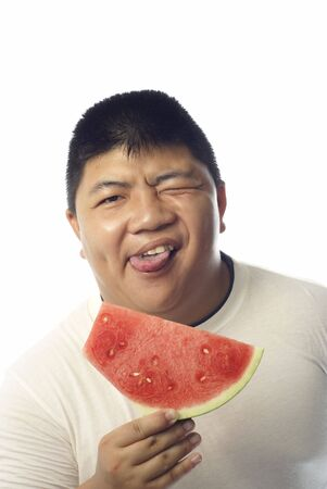 stocky: Asian muscular man funny face and water melon