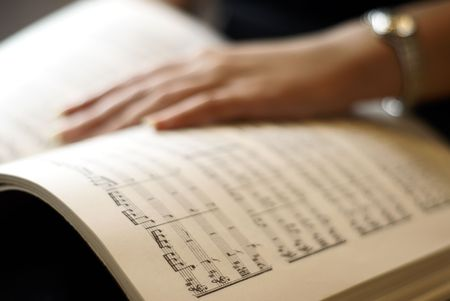 lyrical: Female hand on musical score book page
