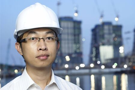 worksite: Asian construction engineer at worksite  Stock Photo