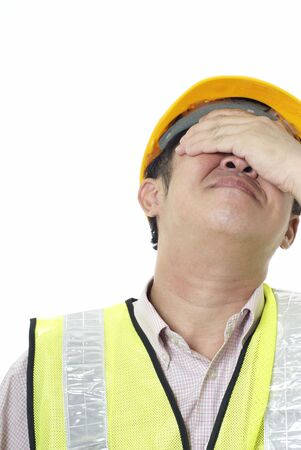 regret: Asian construction contractor with regret expression