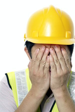Asian construction contractor hands covering face on white background