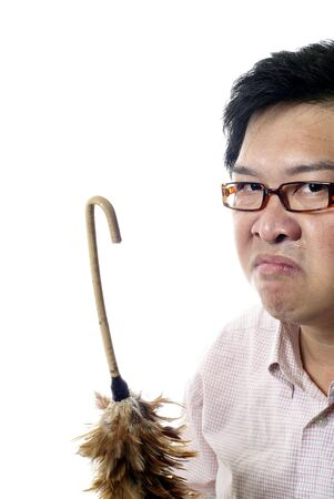 angry teacher: Angry teacher with feather duster cane on white background Stock Photo
