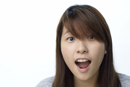 Surprised asian teen lady with white background Stock Photo - 9137149
