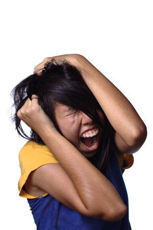 anguish: Frustrated asian teen girl on white