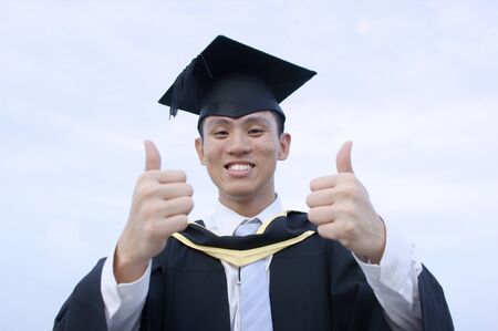 Happy asian graduate thumbs up photo