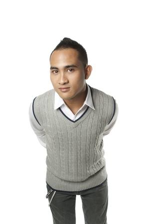 leaning forward: Friendly asian man leaning forward on white