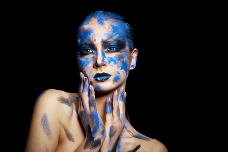 blue face: girl in blue paint on her face