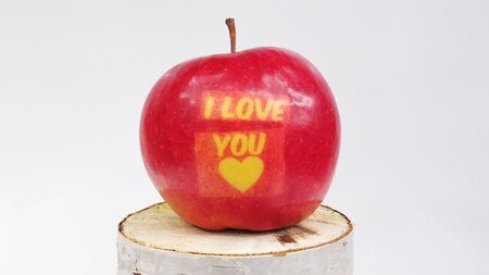 subtitles: Red apple with the words I love you on a light background Stock Photo