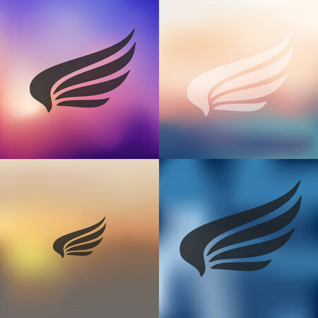 wings bird: wing icon on blurred background