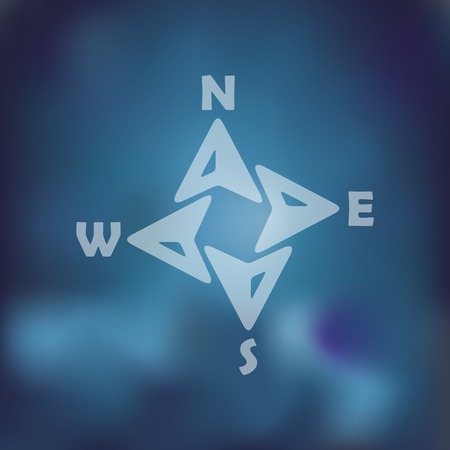 wind rose: compass icon on blurred background