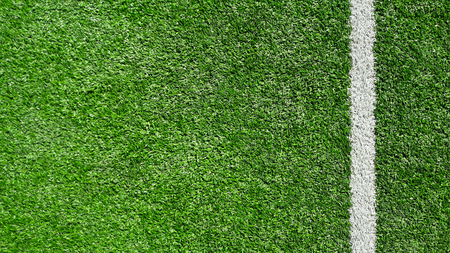 Photo of a green synthetic grass sports field with white line shot from above. Banco de Imagens