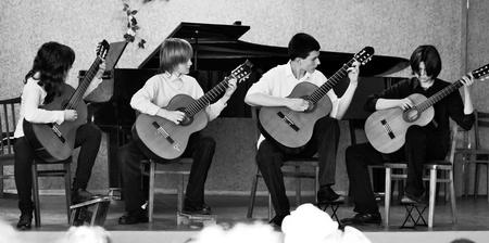 talent show: Guitar quartet of Musical school 2,Dnepropetrovsk, Ukraine - SEPTEMBER 2010.Guitar quartet performance Editorial
