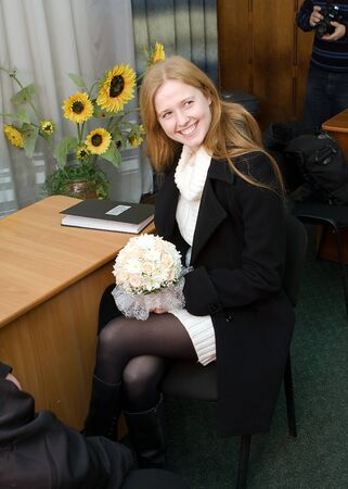 fiancee: a young fiancee smiling  and waiting for the registration