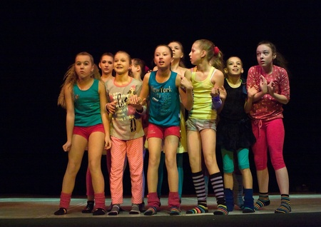 SCHOOL-THEATRE OF MODERN DANCE POTOKI,DNEPROPETROVSK, UKRAINE -January 2012, Winter Entertainment Jump.Teenagers dancers perform on a stage of a local theatre