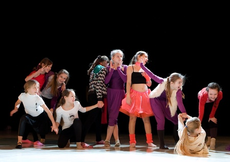 SCHOOL-THEATRE OF MODERN DANCE POTOKI,DNEPROPETROVSK, UKRAINE -January 18, 2012. Winter Entertainment JUMP.Teenagers class dancers. General rehearsal before the concert.
