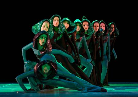 SCHOOL-THEATRE OF MODERN DANCE POTOKI,DNEPROPETROVSK, UKRAINE -January 18, 2012. Winter Entertainment JUMP.Teenagers class dancers perform composition The snake on a stage of a local theatre