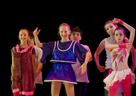 SCHOOL-THEATRE OF MODERN DANCE POTOKI,DNEPROPETROVSK, UKRAINE -January 18, 2012. Winter Entertainment JUMP.Teenagers class dancers perform composition Mannequinson a stage of a local theatre