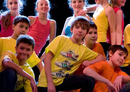 SCHOOL-THEATRE OF MODERN DANCE POTOKI,DNEPROPETROVSK, UKRAINE -January 18 2012. Winter Entertainment JUMP.Teenagers class dancers perform composition Street movements on a stage of a local theatre. Editorial