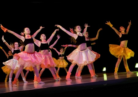 SCHOOL-THEATRE OF MODERN DANCE POTOKI,DNEPROPETROVSK, UKRAINE -January 18,2012. Winter Entertainment JUMP.Teenager class dancers perform a composition Jazz on a stage of the local theatre
