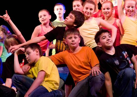 SCHOOL-THEATRE OF MODERN DANCE POTOKI,DNEPROPETROVSK, UKRAINE -June 2, 2011. Summer Entertainment City Windows.Teenagers class dancers perform composition Street movements on a stage of a local theatre.