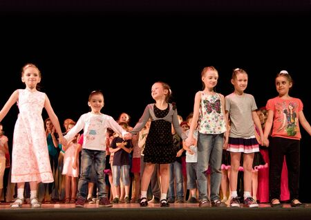frienship: School-theatre of modern dance POTOKI,Dnepropetrovsk, Ukraine -June 5, 2012. Summer Entertainment  Polyphony. Children class awarding,feelings of happiness Editorial