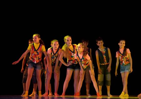 frienship: DNEPROPETROVSK,UKRAINE - JUNE 5, 2012 - School-theatre of Modern dance POTOKI,Dnepropetrovsk. Summer Annual Entertainment (Polyphony). Teenagers and sport classes dancers perform composition  Little thieves