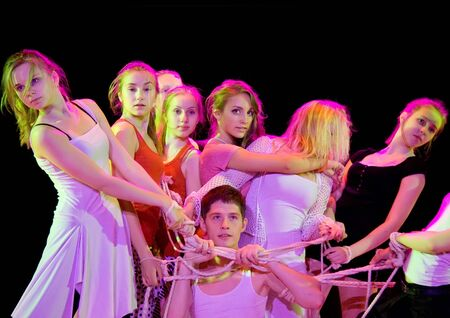 frienship: DNEPROPETROVSK,UKRAINE - JUNE 5, 2012 - School-theatre of Modern dance POTOKI,Dnepropetrovsk. General rehearsal of Summer Annual Entertainment  (Polyphony). Adults class dancers perform composition  Tango