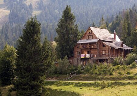A small chalet on the green hill, Carpathian landscape Stock Photo - 16043222