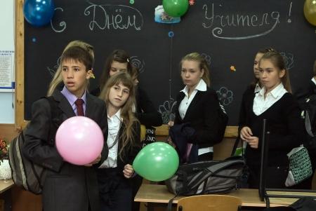 specialization: DNEPROPETROVSK,UKRAINE - October, 2012: Lyceum of Information Technologies,Dnepropetrovsk. Teachers  Day, pupils of lyceum wait for the teacher