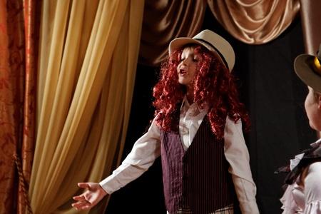 monologue: DNEPROPETROVSK,UKRAINE - MARCH, 2012- Artists of Children theatre perform in a music show Scotish ballads