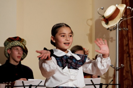 DNEPROPETROVSK,UKRAINE - MARCH, 2012- Artists of Children theatre perform in a music show Scotish ballads