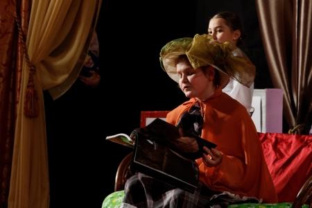 scotish: DNEPROPETROVSK,UKRAINE - MARCH, 2012- Artists of Children theatre perform in a music show Scotish ballads